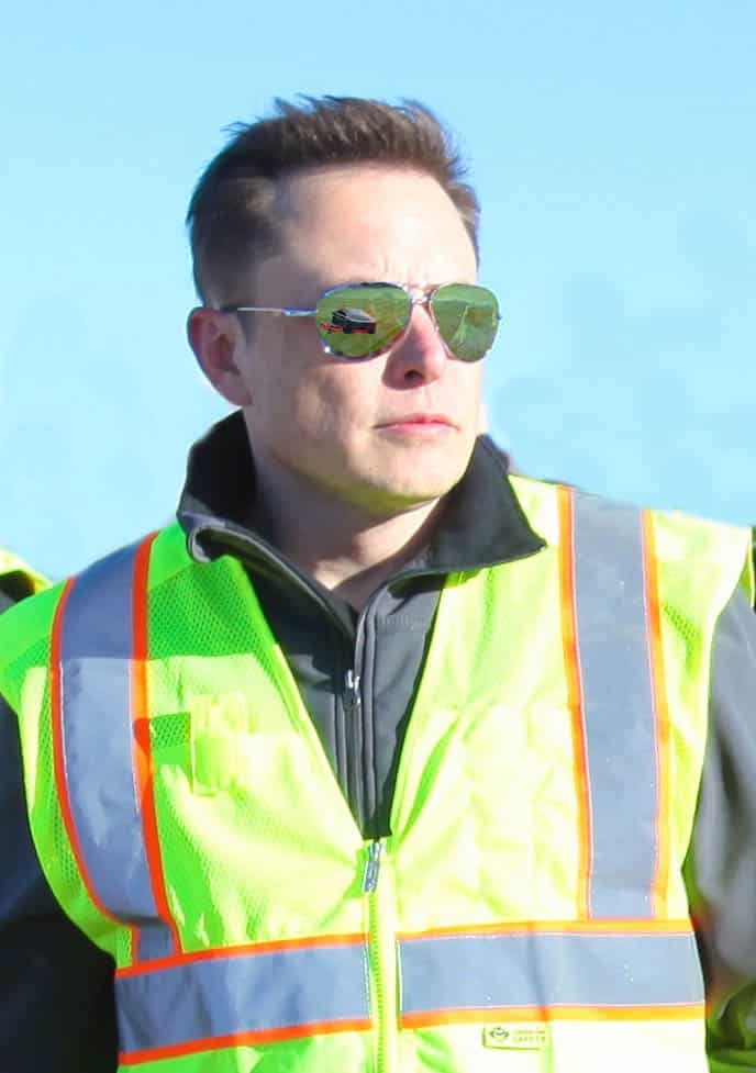 Musk observes as the Cybermower's production capabilities are shown.